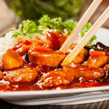 Sweet and sour chicken with rice on a plate; Shutterstock ID 210106621; Purchase Order: -